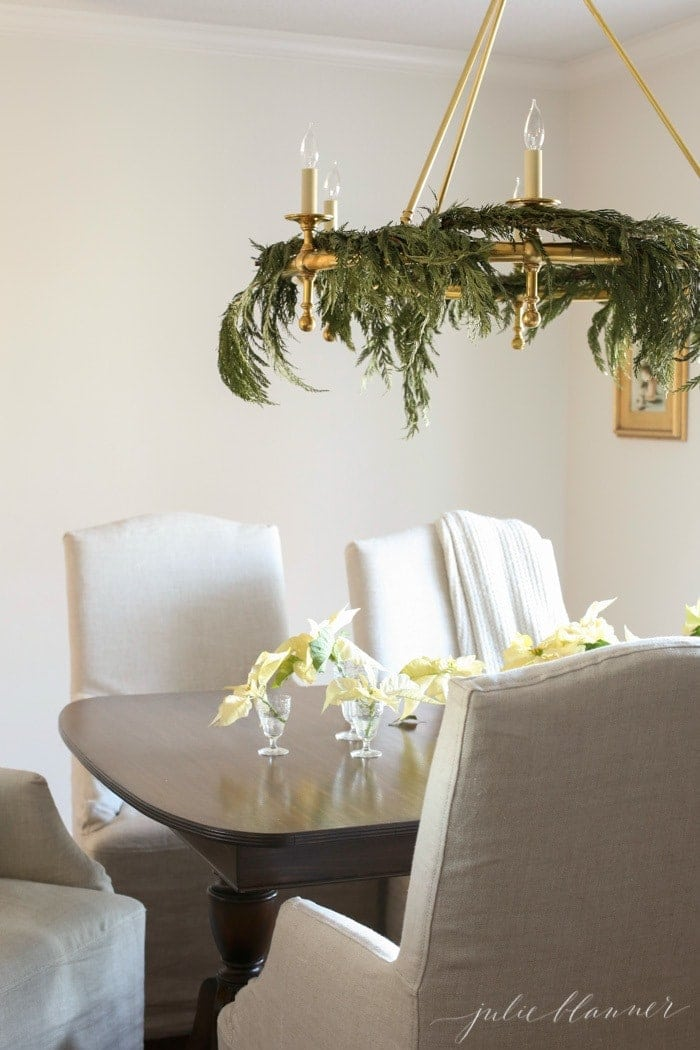 natural Christmas decorating ideas | poinsettias and greens on a chandelier