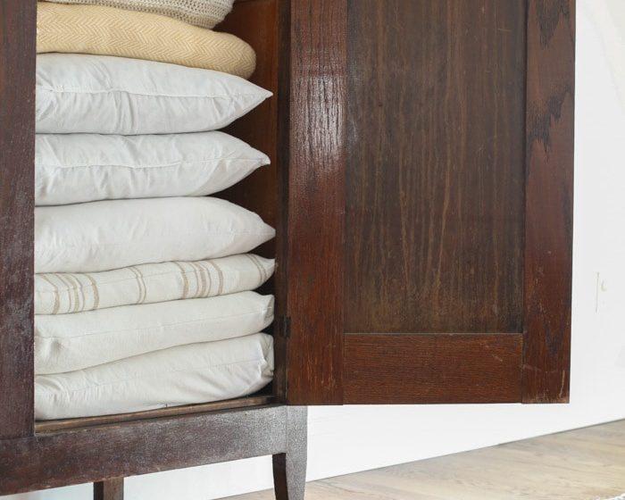 Living room organization - linen closet