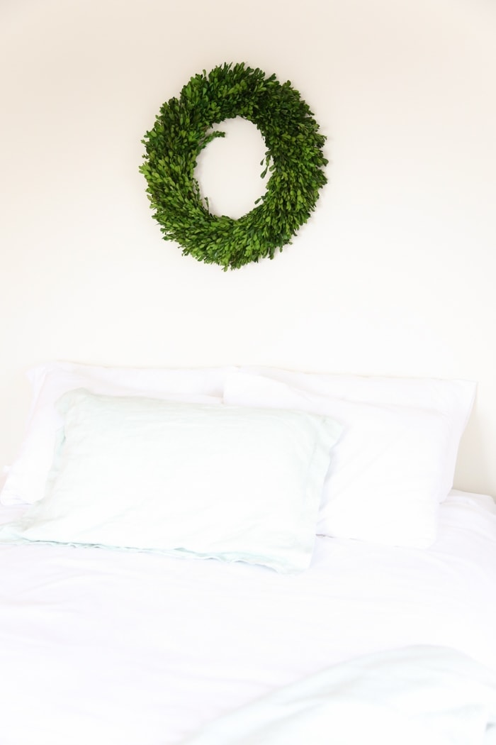 a boxwood wreath is an easy way to integrate the holidays into your home