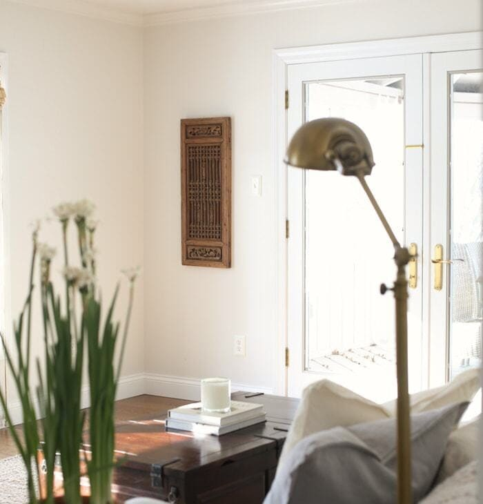 add interest to a room by using antique panels as art