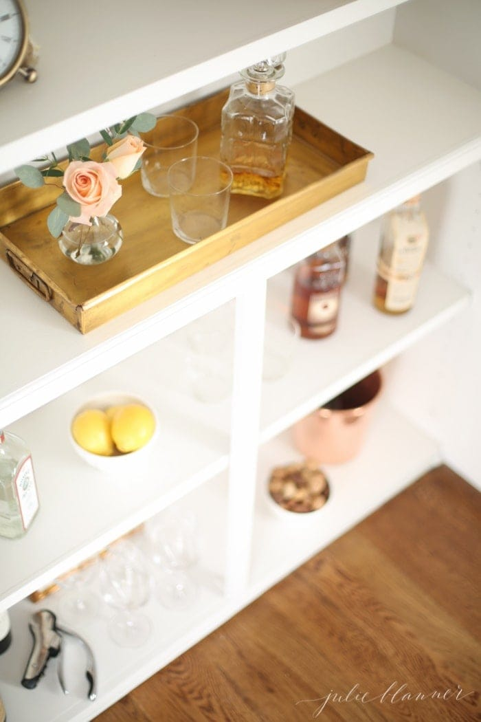 Entertaining blogger Julie Blanner converted her built in bookcases into a beautiful bar cabinet