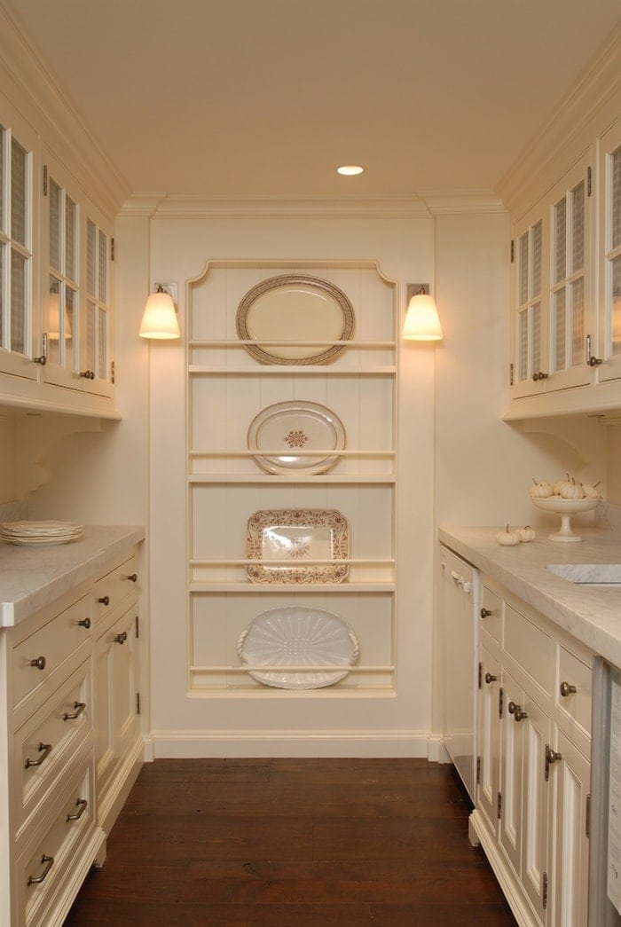 Beautiful butler's pantry - cream cabinets, aged brass hardware, beautiful molding