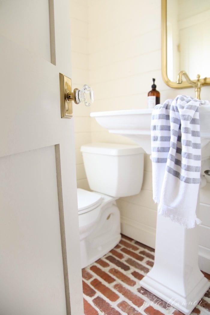 Home design blogger Julie Blanner shares her powder room transformation that blends utility and design