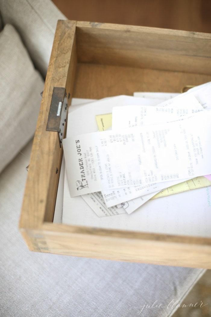 A messy desk drawer full of receipts before a full home office organization.