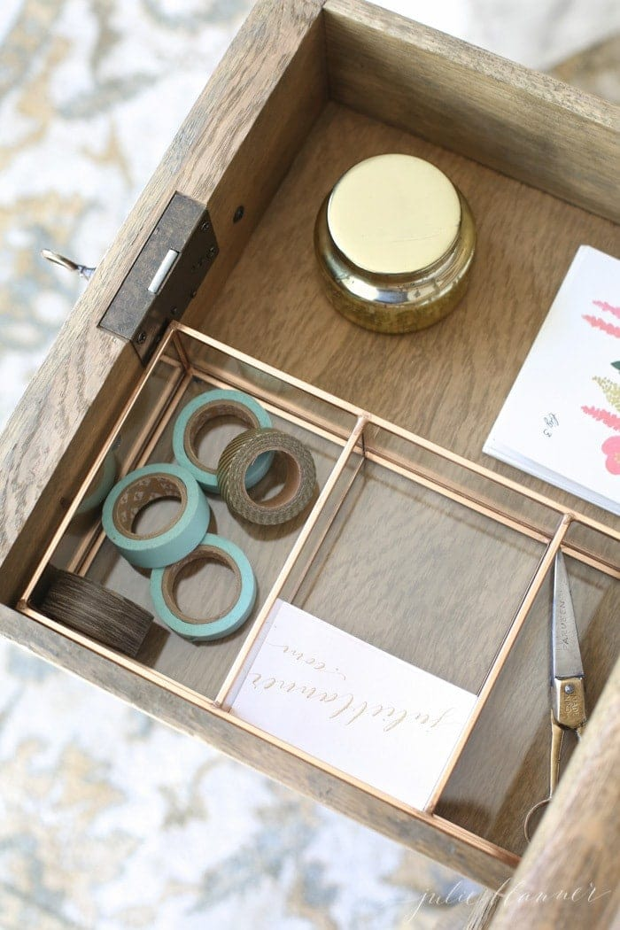 Inside a beautifully organized desk drawer with desk organization ideas.