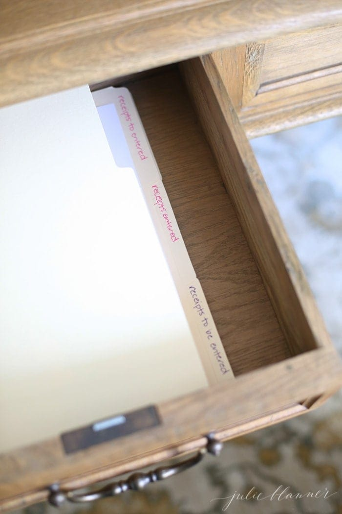 Files organized in a desk drawer and more home office organization ideas.