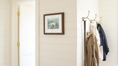 mudroom with brick floors