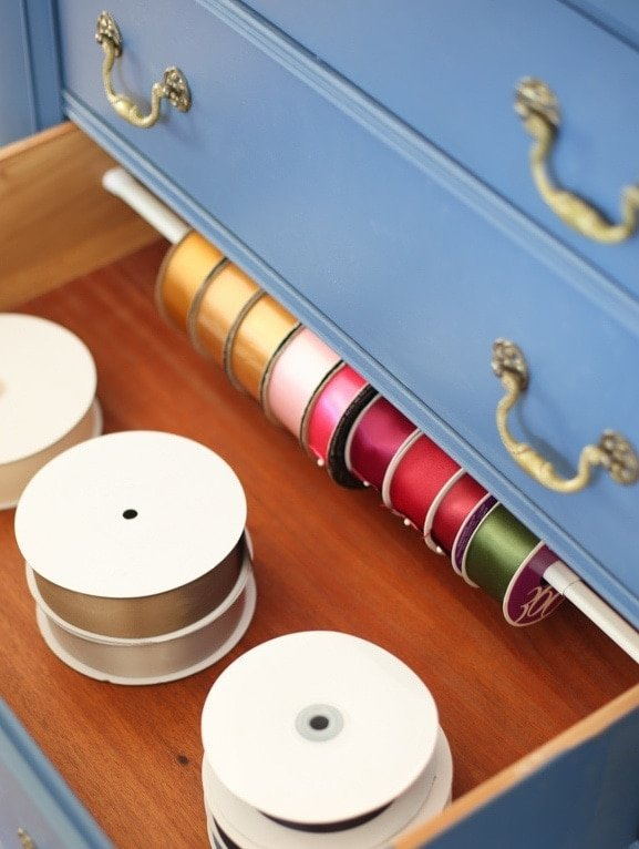 An organized craft drawer full of organized ribbon and more desk organization ideas.