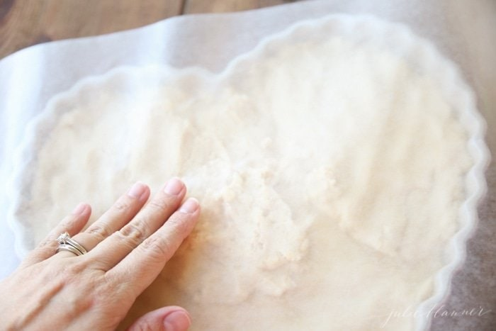 Pressing down on the batter with parchment