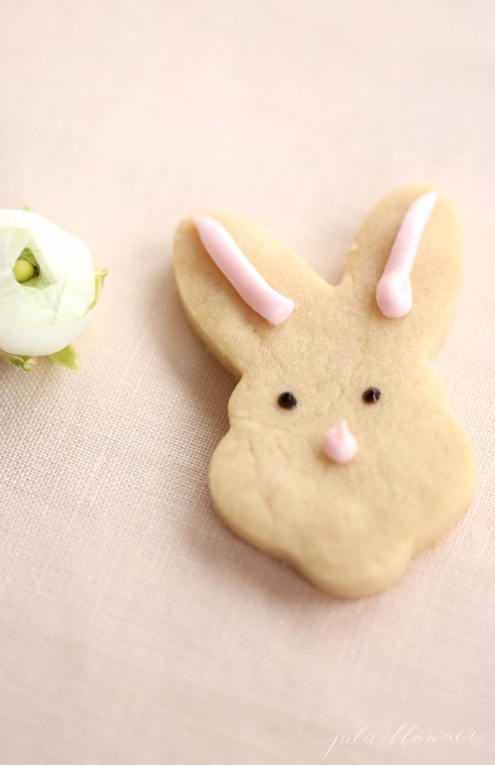 butter shortbread cookies recipe cutout in the shape of a bunny with white flower