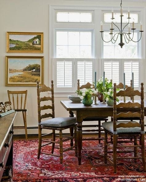 breakfast room decor - beautiful chandelier, traditional rug, wood dining set and art