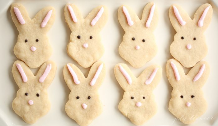 3 ingredient shortbread cookies in shape of bunnies on white platter