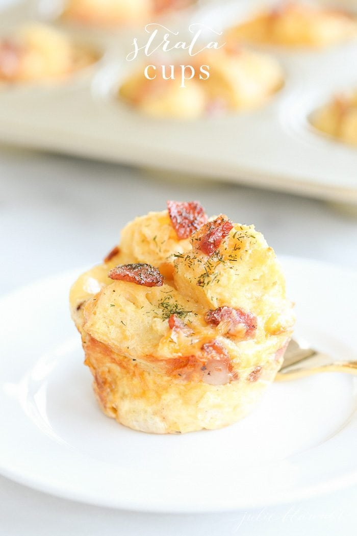 egg strata on a white plate with muffin tin and text overlay