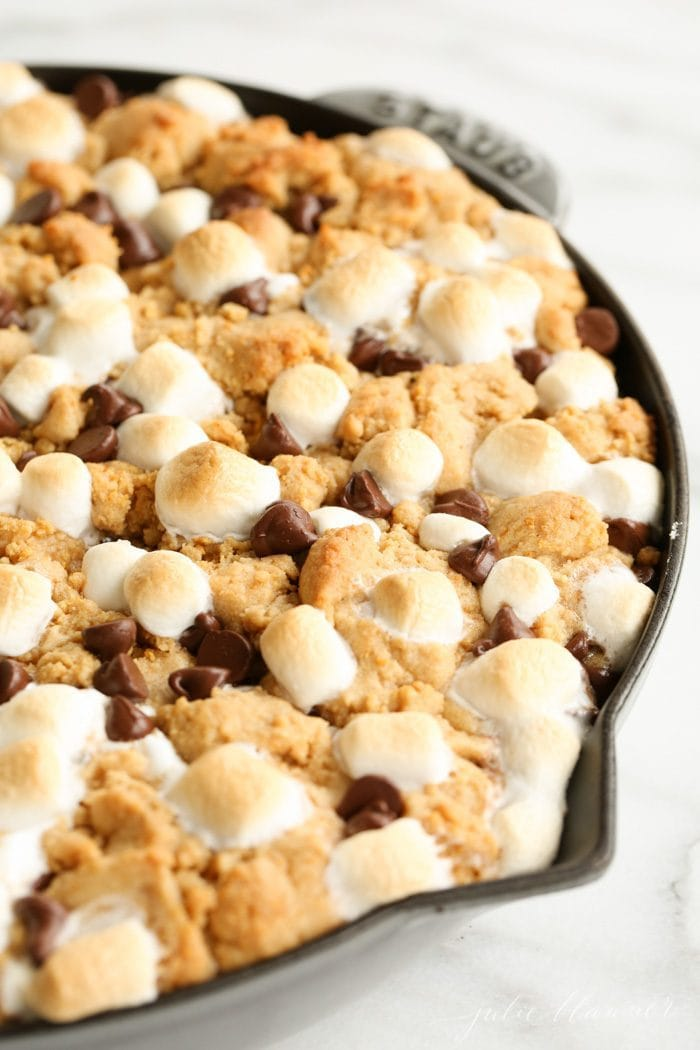 Ridiculously good and incredibly easy peanut butter s'mores pie recipe. You'll always have a crowd pleasing dessert on hand with this s'mores pie.