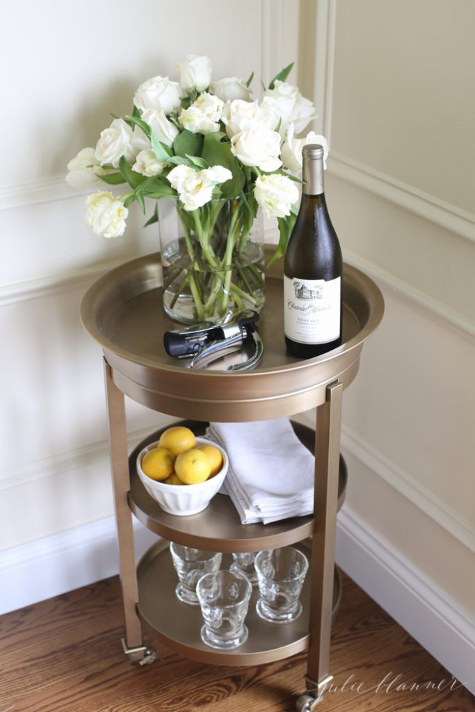 functional furniture - a versatile brass side table doubles as a bar cart for entertaining