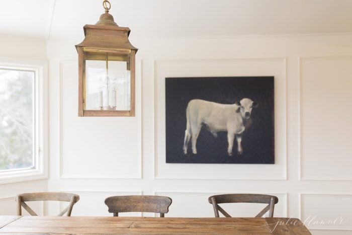 cow painting over breakfast nook table