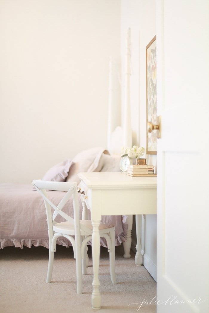 A little girl's bedroom with a white desk and chair found in a Craigslist search.