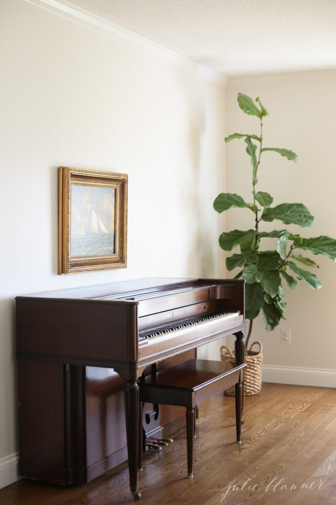 beautiful family room ideas | fiddle fig piano and sailboat painting