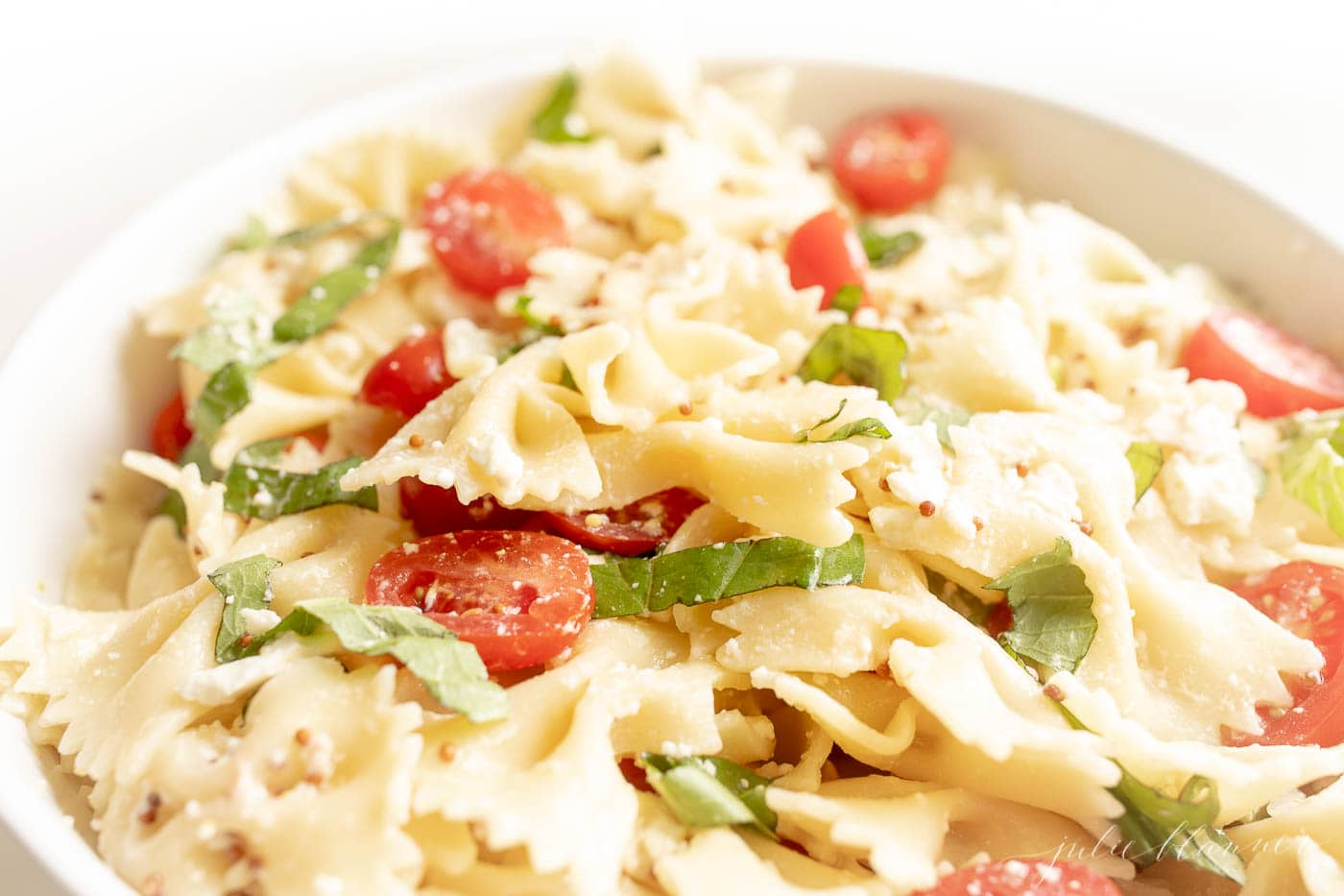 bow tie pasta salad with lemon vinaigrette basil and cherry tomatoes