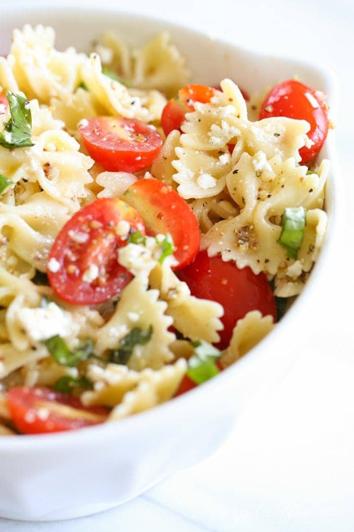 pasta salad dressing tossed with bow tie pasta