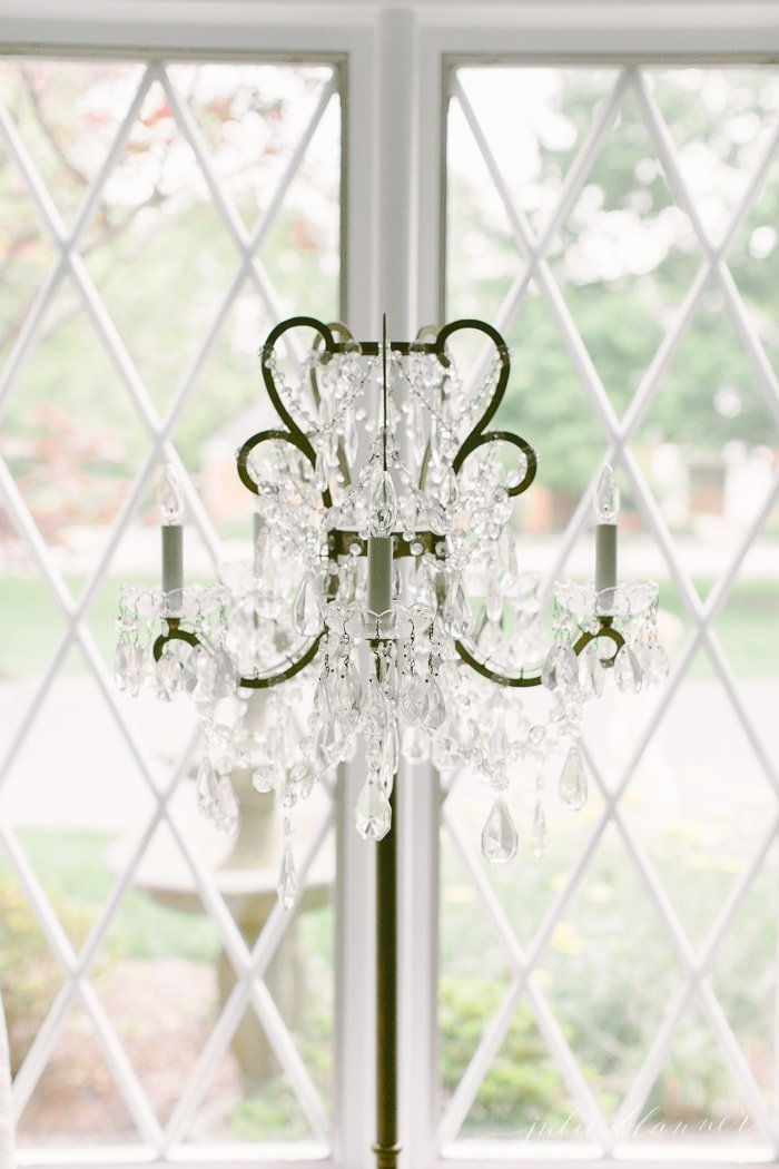 don't have a living room light but want to make a statement? use a chandelier lamp