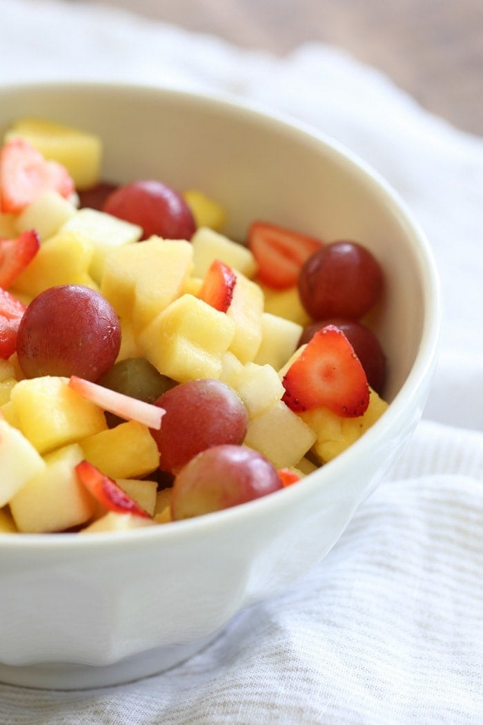 Close up of a bowl of vanilla fruit salad