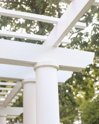 beautiful front porch with a pergola