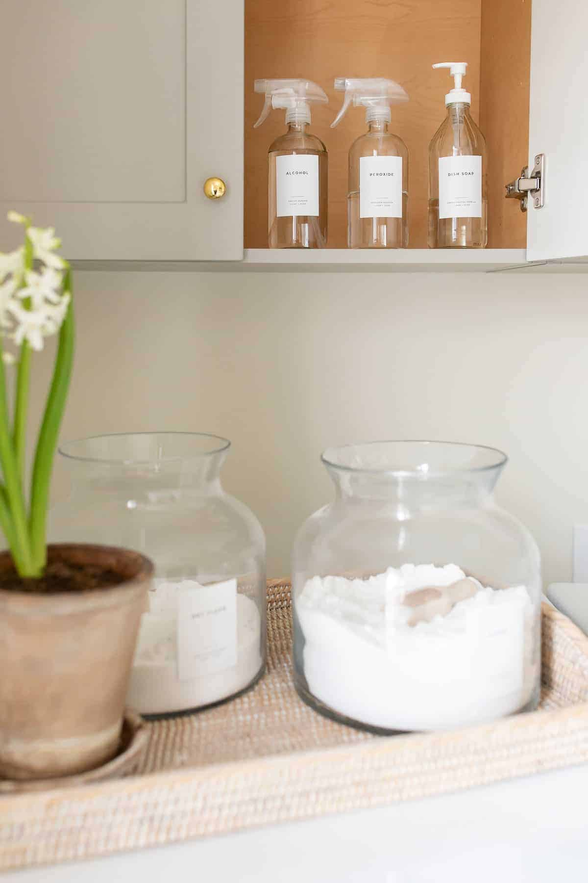laundry room cabinet and tray filled with detergents
