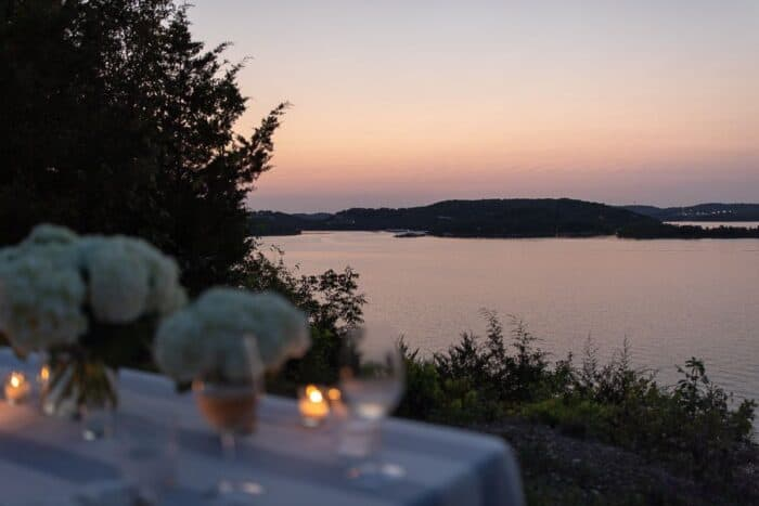 A table set up with sunset water views for al fresco dining.