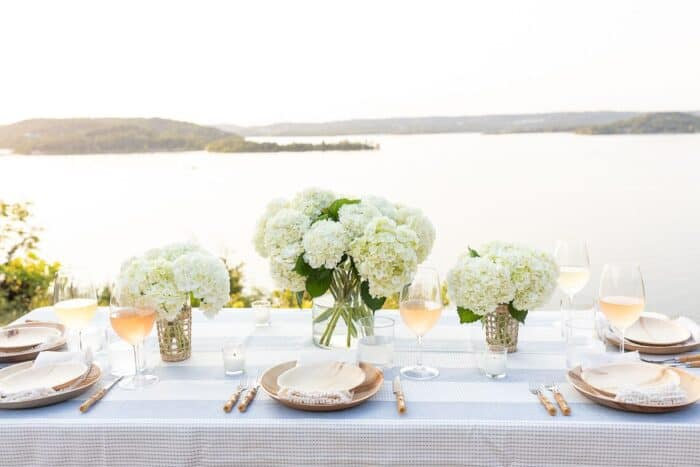 A table set up with water views for al fresco dining.