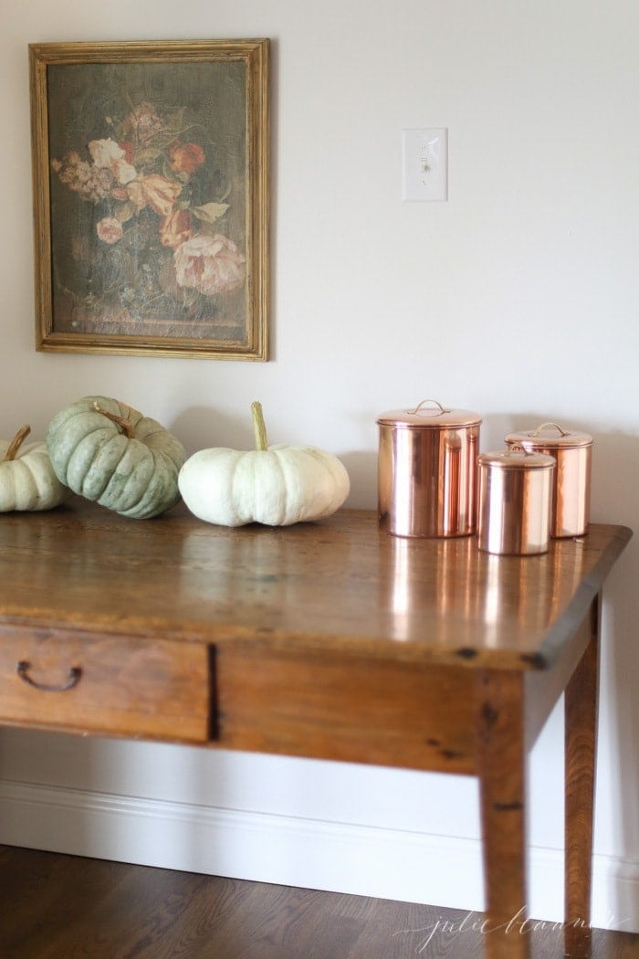 antique table repurposed as a kitchen desk decorated for fall