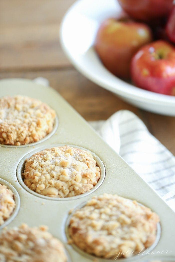 Baked Apple Cobbler Muffins in a muffin tin