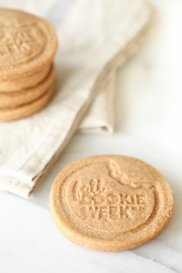 fall cookie week stamped cookies stacked on a napkin