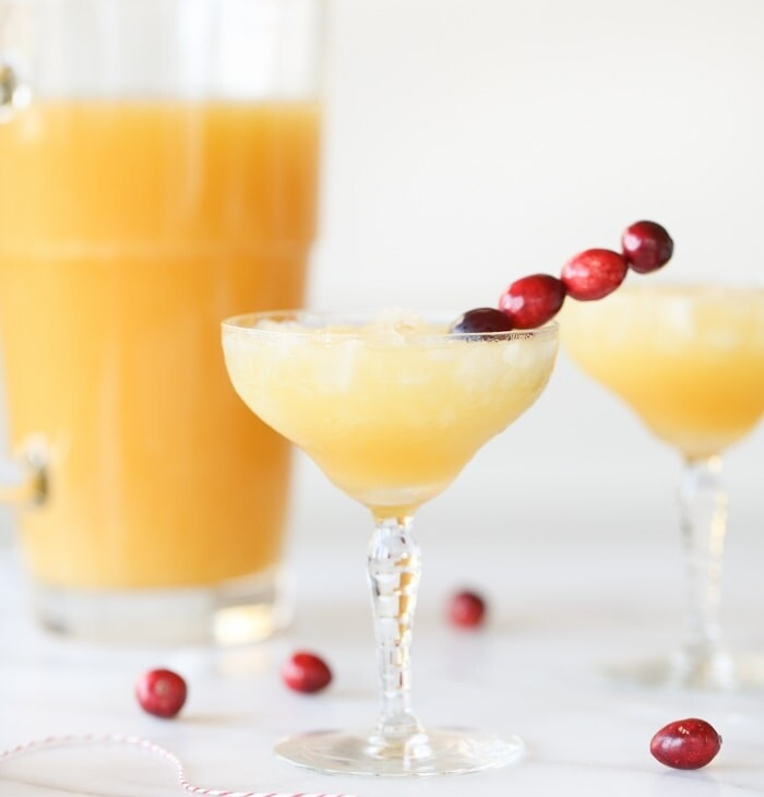 Mtwo mai tais garnished with cranberries