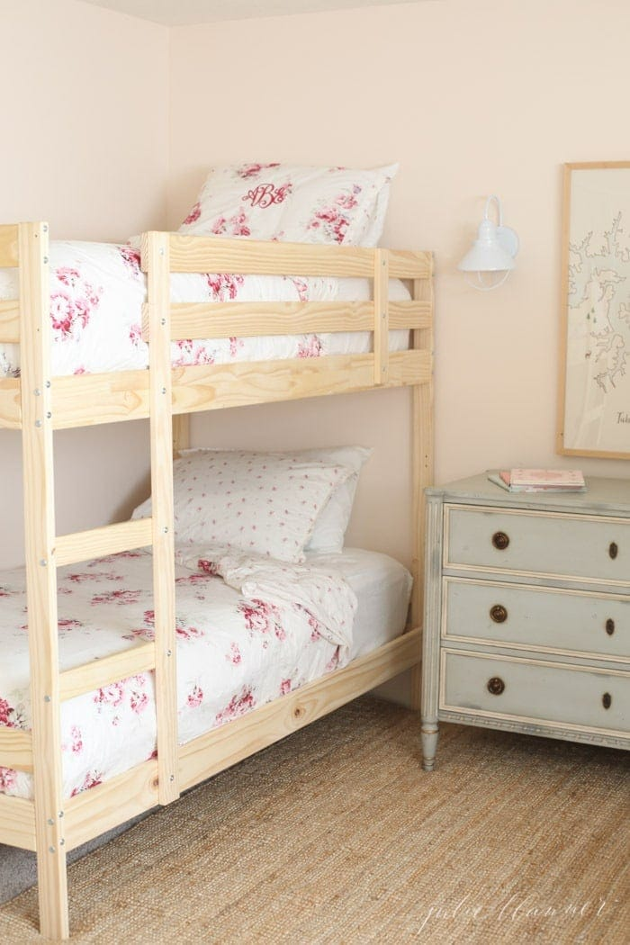 An inexpensive children's Solid Wood Bunk Bed room makeover, without a lot of effort! Perfect solution for families with multiple kids or fun Twin Over Twin Bunk Beds at grandma's house. #bunkroom #woodbunkbeds #girlsbunkbedroom #doublebunkroom