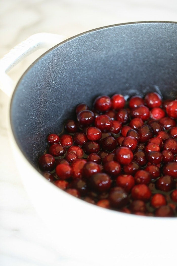 Cranberries cooking in a pot
