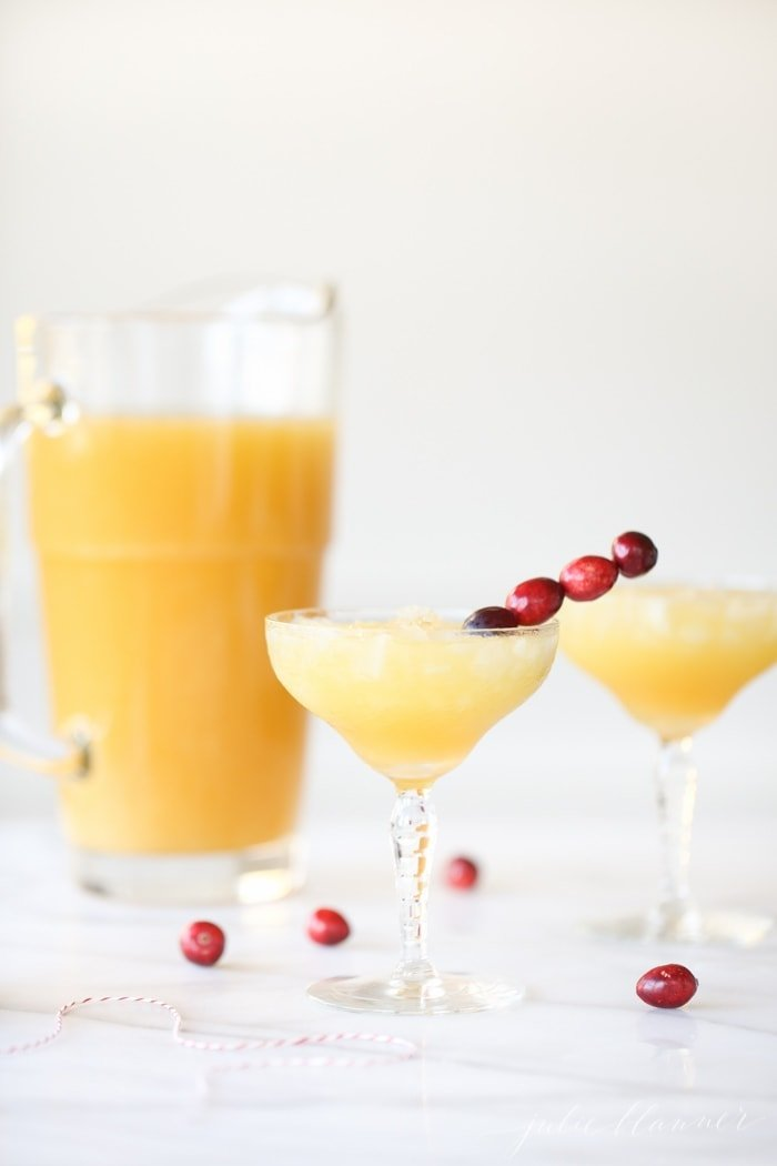 Two cocktails garnished with cranberries
