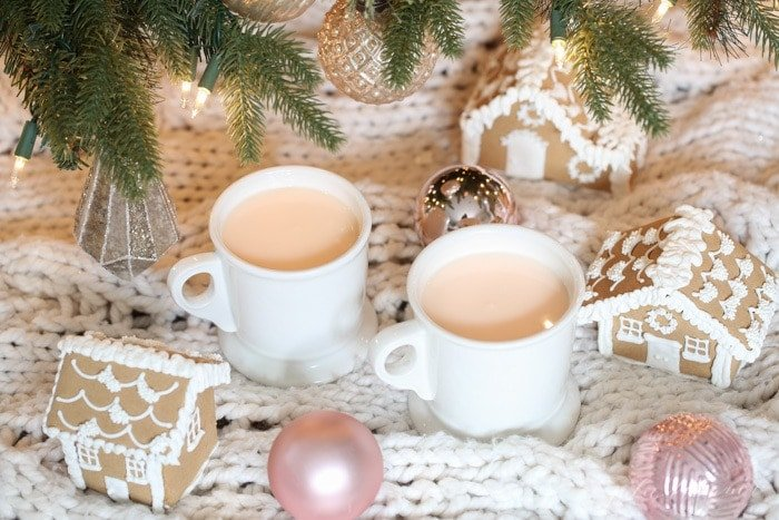 pink hot chocolate under christmas tree