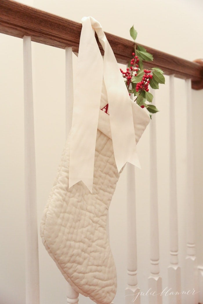 festive Christmas decorations | ivory stockings filled with holly