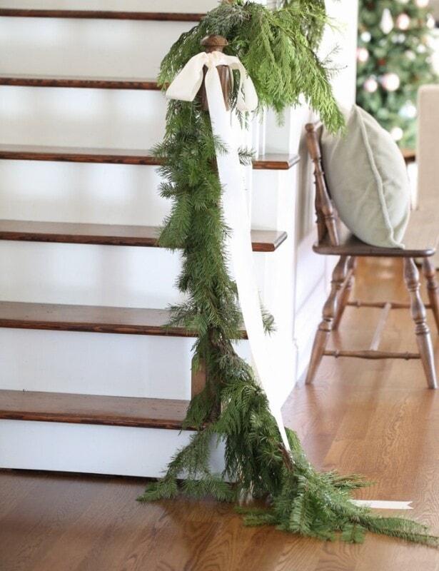 beautiful Christmas decorations | garland draped on banister