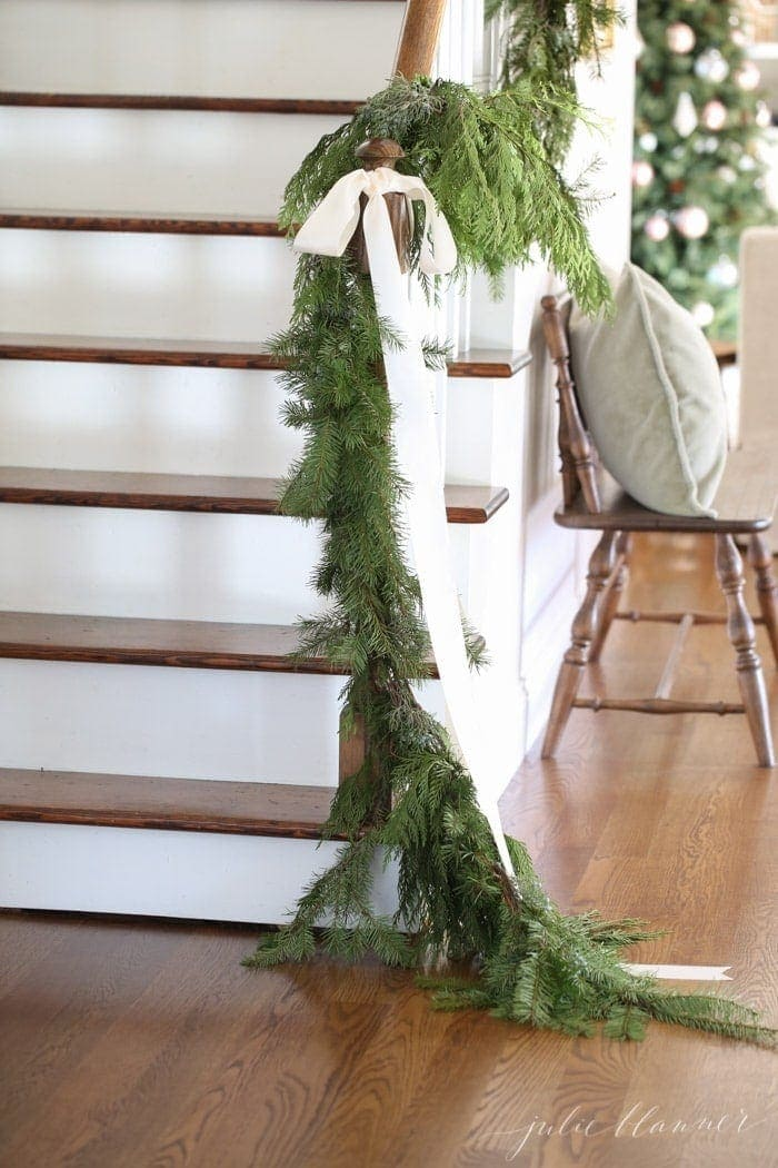 beautiful Christmas decorations | garland draped on banister