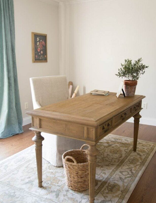 traditional home office with a floating wood partners desk and walls painted zurich white