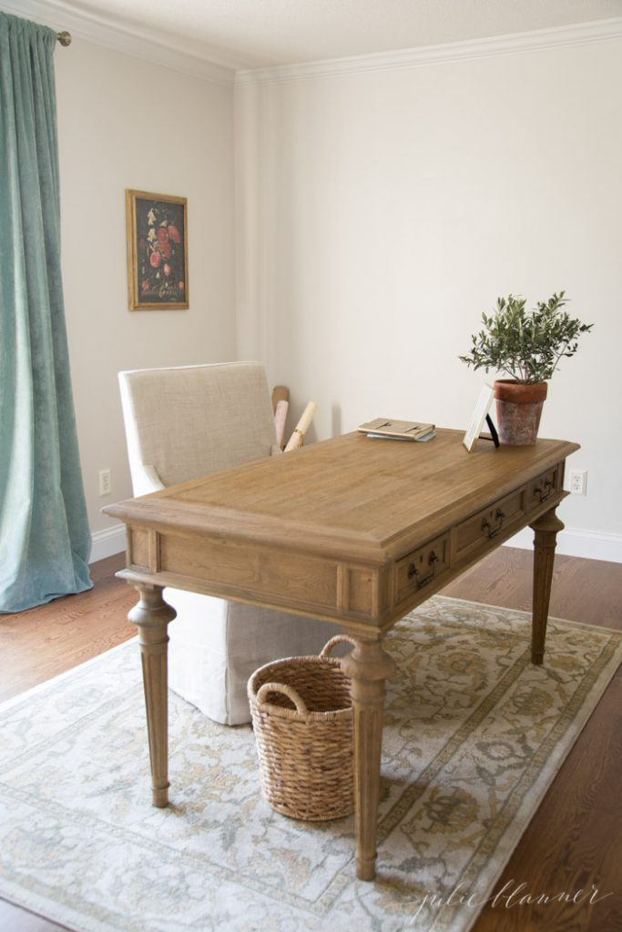 traditional home office with a floating wood partners desk