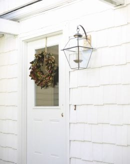 quaint cottage home tour with a brass lantern and shaker shingles