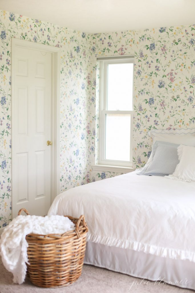 charming cottage guest room with floral wallpaper ruffle duvet and scallop bedding