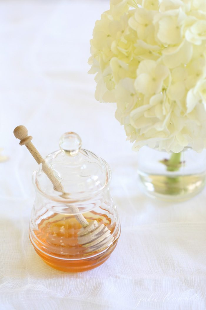 A glass jar with honey in it