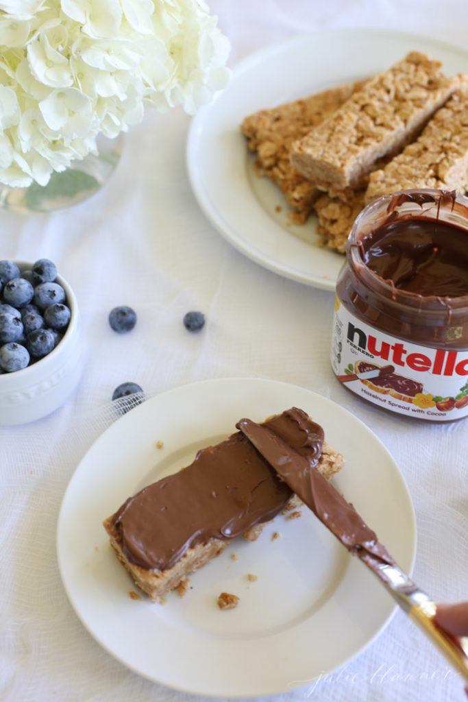 easy entertaining idea - granola bars with a toppings bar of fruits, nuts, coconut, Nutella and more!
