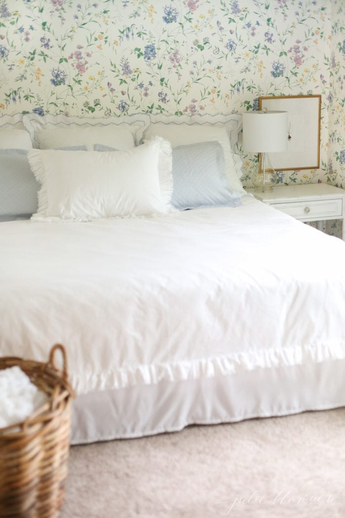 give the illusion of a headboard by using pillows