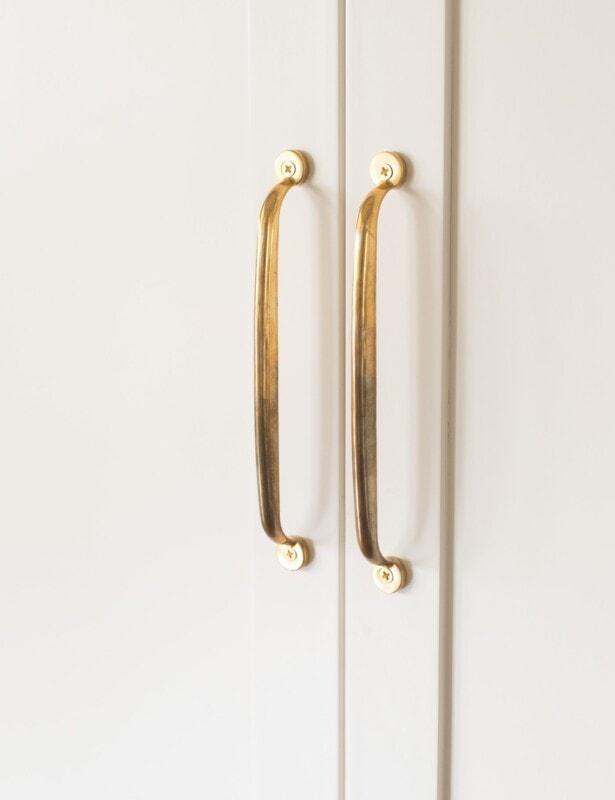 unlacquered brass appliance pulls on refrigerator