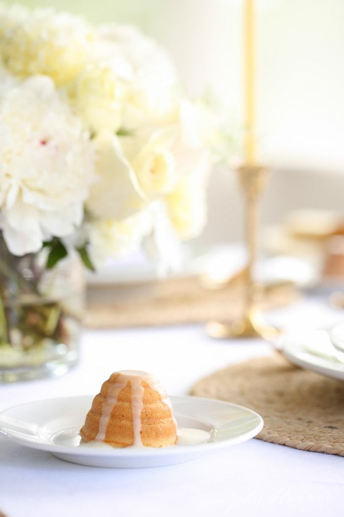 table setting with flowers and dessert plate with honey lemon beehive cake